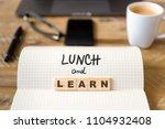 closeup on notebook over wood... | Shutterstock . vector #1104932408