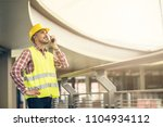 civil engineer wearing safety... | Shutterstock . vector #1104934112