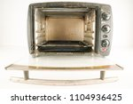 small electric oven | Shutterstock . vector #1104936425