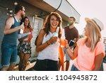happy young girls having fun at ... | Shutterstock . vector #1104945872