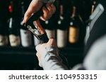 opening a wine bottle. | Shutterstock . vector #1104953315