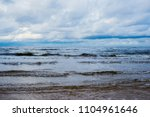 waves of the baltic sea under a ... | Shutterstock . vector #1104961646