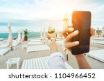 someone is holding a phone and... | Shutterstock . vector #1104966452