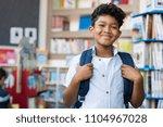 portrait of smiling hispanic... | Shutterstock . vector #1104967028