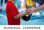 child in a sportswear receiving ...   Shutterstock . vector #1104969668