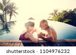 a honeymoon couple enjoying... | Shutterstock . vector #1104976232