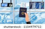 hand with passport and airline... | Shutterstock .eps vector #1104979712