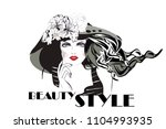 fashion woman in a hat with... | Shutterstock .eps vector #1104993935