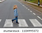little boy crossing alone on... | Shutterstock . vector #1104995372