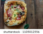 hot juicy small homemade pizza... | Shutterstock . vector #1105012556