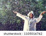 rainy day asian woman wearing a ... | Shutterstock . vector #1105016762
