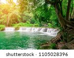 the beauty of the waterfall and ... | Shutterstock . vector #1105028396