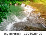 the beauty of the waterfall and ... | Shutterstock . vector #1105028402