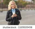 fashion woman in black leather... | Shutterstock . vector #1105035458