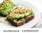 healthy avocado toasts for... | Shutterstock . vector #1105043105