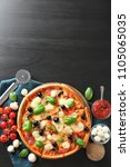 tasty italian pizza and... | Shutterstock . vector #1105065035