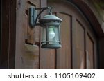 lamp lantern wood wall garage... | Shutterstock . vector #1105109402