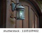 lamp lantern wood wall garage...   Shutterstock . vector #1105109402