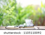 white cup with white flower and ... | Shutterstock . vector #1105110092