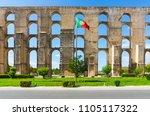 amoreira aqueduct and flag of... | Shutterstock . vector #1105117322