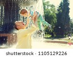 outdoor portrait of father and... | Shutterstock . vector #1105129226