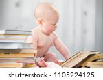a little boy is looking at a... | Shutterstock . vector #1105224125
