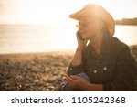 beautiful senior woman speak at ...   Shutterstock . vector #1105242368