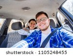 couple driving car. car travel... | Shutterstock . vector #1105248455