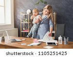 happy mother working at office... | Shutterstock . vector #1105251425