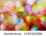 Small photo of Pile of pills in color fantasy with psychedelic colors showing confusion or disorientation due to drugs