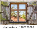 old rustic window of a... | Shutterstock . vector #1105273685