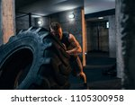 young man flipping a tire at... | Shutterstock . vector #1105300958