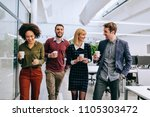 group of coworkers having a... | Shutterstock . vector #1105303472