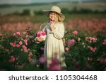 cute child girl is holding... | Shutterstock . vector #1105304468