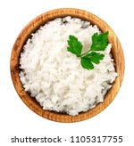 Rice In A Wooden Bowl Isolated...
