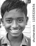 Small photo of Dhaka, Bangladesh - 10 29 2016: Boy Smiling (Black & White). Asian youthful cute kid enjoying life. Poor boy working. Youth going school. World street children need Government, NGO financial help