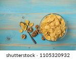 tasty cornflakes with walnut in ... | Shutterstock . vector #1105320932