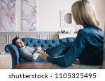 happy man visiting psychologist ... | Shutterstock . vector #1105325495