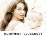 beatiful mother and child girl... | Shutterstock . vector #1105328195