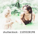 beatiful mother and child girl... | Shutterstock . vector #1105328198