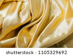 gold fabric in the folds.... | Shutterstock . vector #1105329692