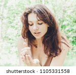 beautiful woman outdoors in... | Shutterstock . vector #1105331558