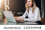 young businesswoman in white... | Shutterstock . vector #1105349948