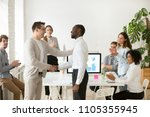 middle aged ceo congratulating... | Shutterstock . vector #1105355945