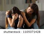 girl comforting her divorced... | Shutterstock . vector #1105371428