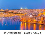 night view of the grand harbour ... | Shutterstock . vector #1105372175