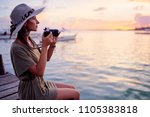 photography and travel. young... | Shutterstock . vector #1105383818