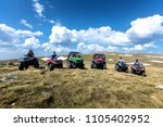 friends driving off road with... | Shutterstock . vector #1105402952