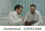 male doctors watching on tablet ...   Shutterstock . vector #1105411688