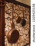 large antique frying pans hang... | Shutterstock . vector #1105425158